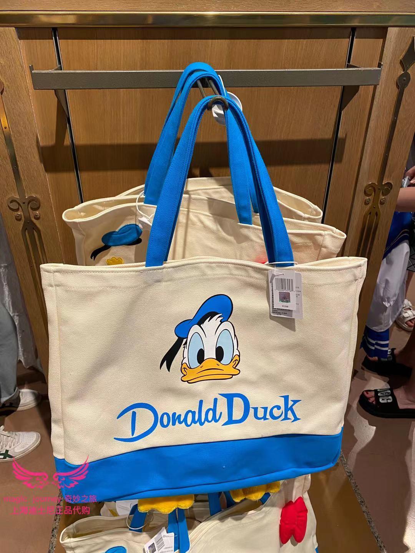 上海迪士尼國內代購唐老鴨捏屁股會蹬腿物袋單肩包手提袋卡通