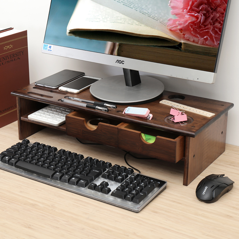 The computer monitor adds an elevated shelf to the LCD screen carrier desk keyboard to house a double-decker base