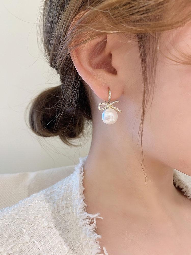 Korean bow pearl earrings women's sterling silver temperament high sense light luxury atmosphere 2021 new trend earrings