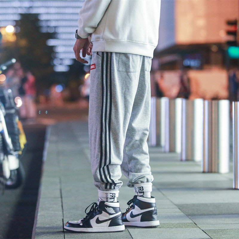 K718 2019秋季三条杠条纹休闲裤男宽松小脚运动裤大码裤子P55