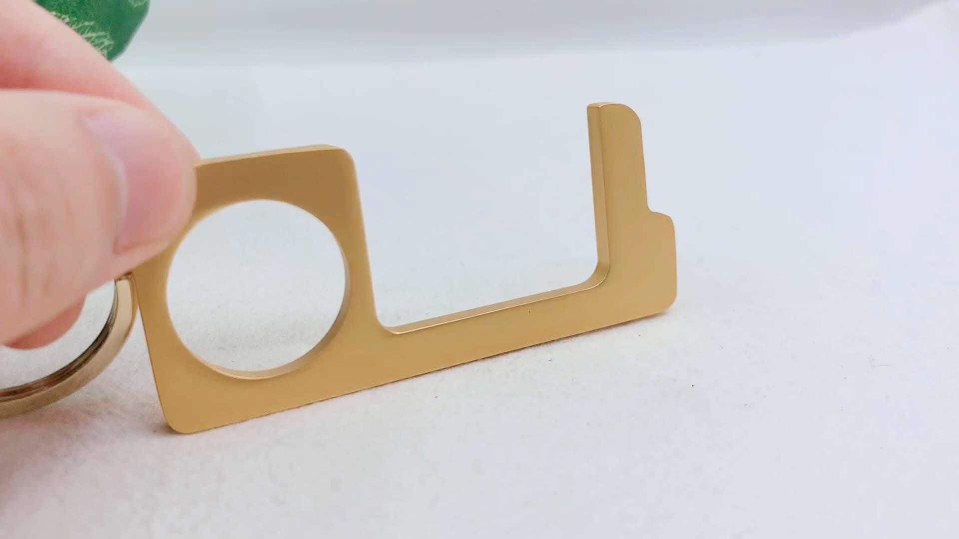 Hot sale wholesale custom metal copper clean no touch door opener key chain