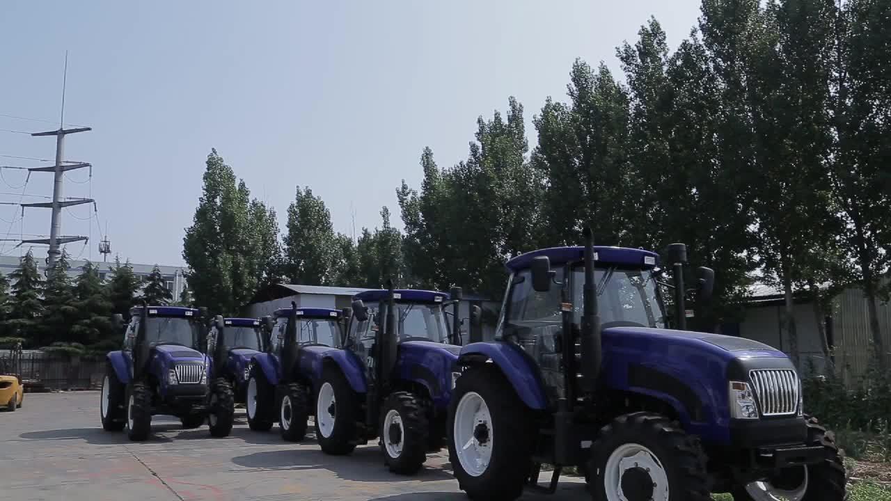 704 70HP trung quốc giá rẻ trang trại bãi cỏ máy kéo nhỏ phía trước kết thúc loader máy kéo và thiết bị