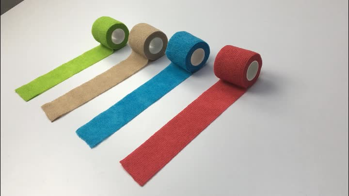 bulk on sale various color nonwoven cohesive bandage for thumb 2.5cm*4.5m with 24 rolls a box