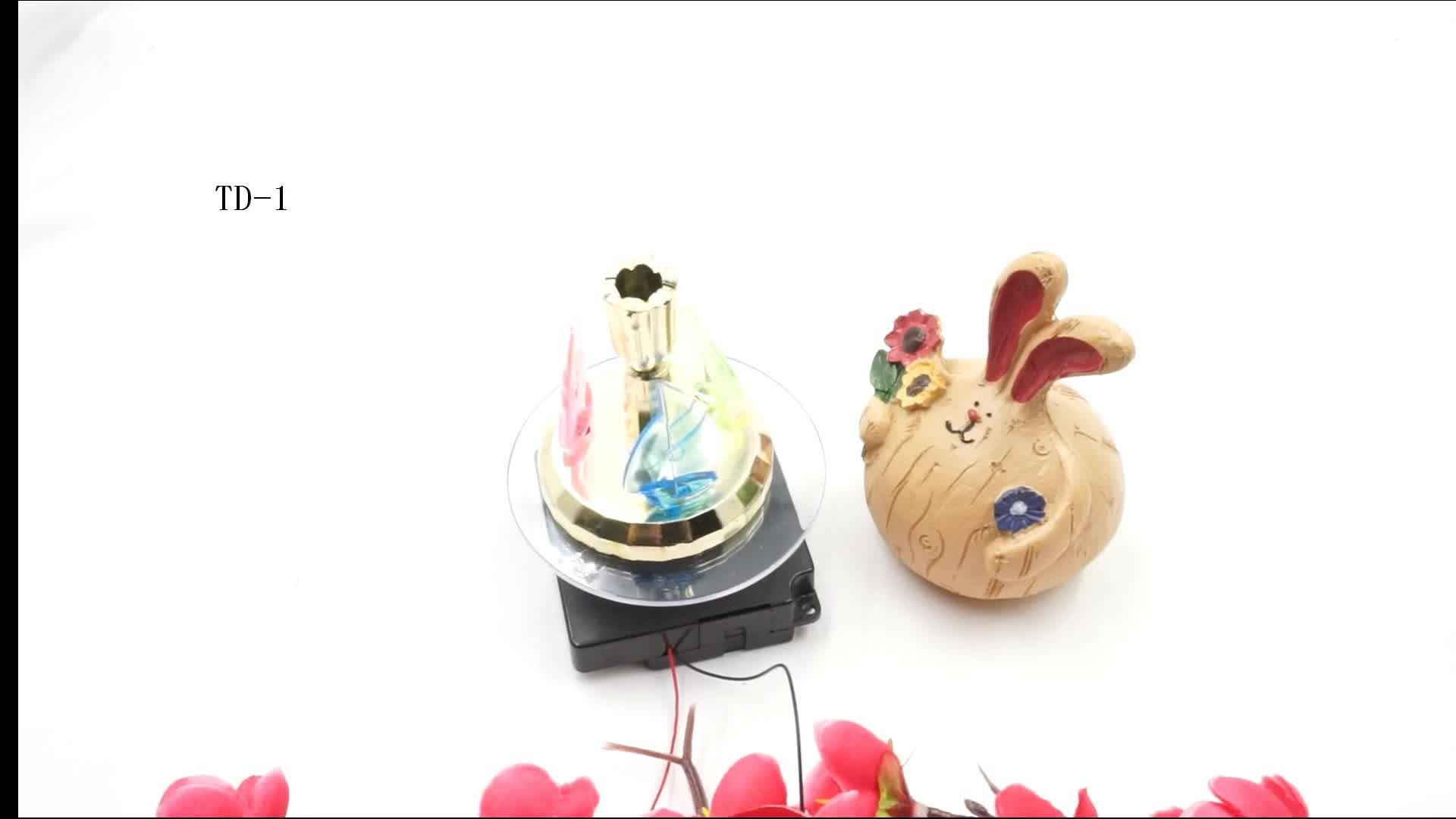 Piccolo rotante decorativo movimento giocattolo di alimentazione rotante