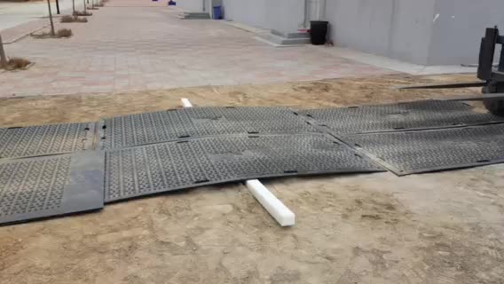 Durable HDPE access over muddy ground mat