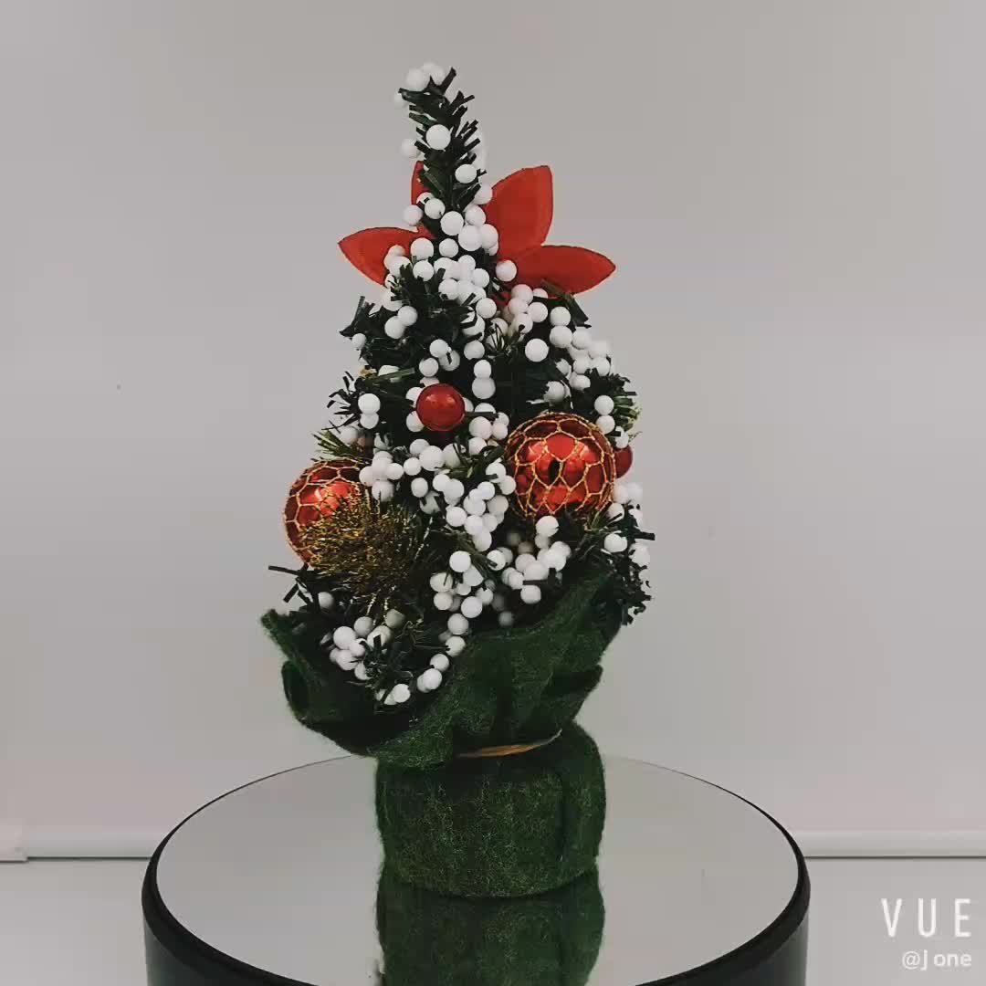 Home table ornament christmas tree with red berries and natural pine cones