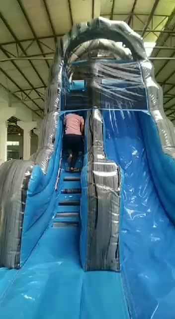 Inflatable dual lane dry slide for commercial use