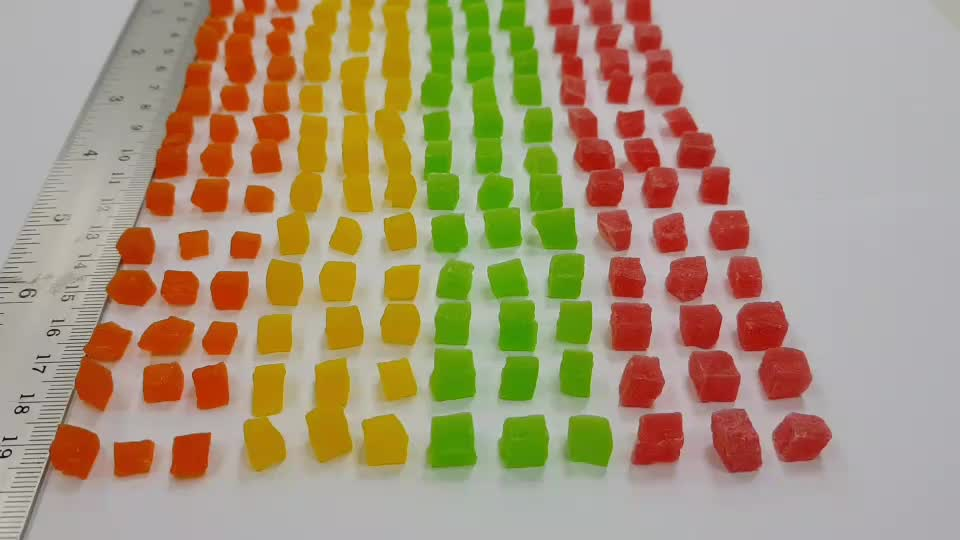 Dried candied Papaya dices 5-7 mm mixed colors added Thailand