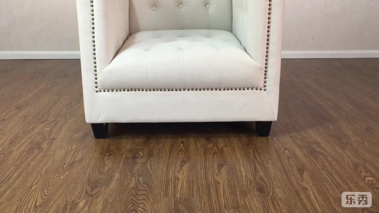 Beige button tufted and nailed lounge chair
