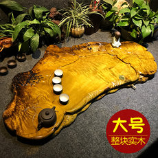 The whole piece of gold nanmu tea tray solid wood large tea sea special Kung Fu tea set root carving tea table drainage tray