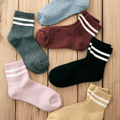 Korean version of the two-bar college style cotton tube socks female spring and autumn new sports solid color wild striped cotton socks