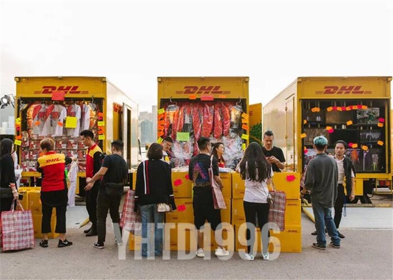 Châu âu và Mỹ thời trang đường phố VTM DHL Hồng Kông giới hạn màu vàng áo gió áo mưa trong phần dài của nam giới và phụ nữ các cặp vợ chồng mùa thu và mùa đông áo khoác