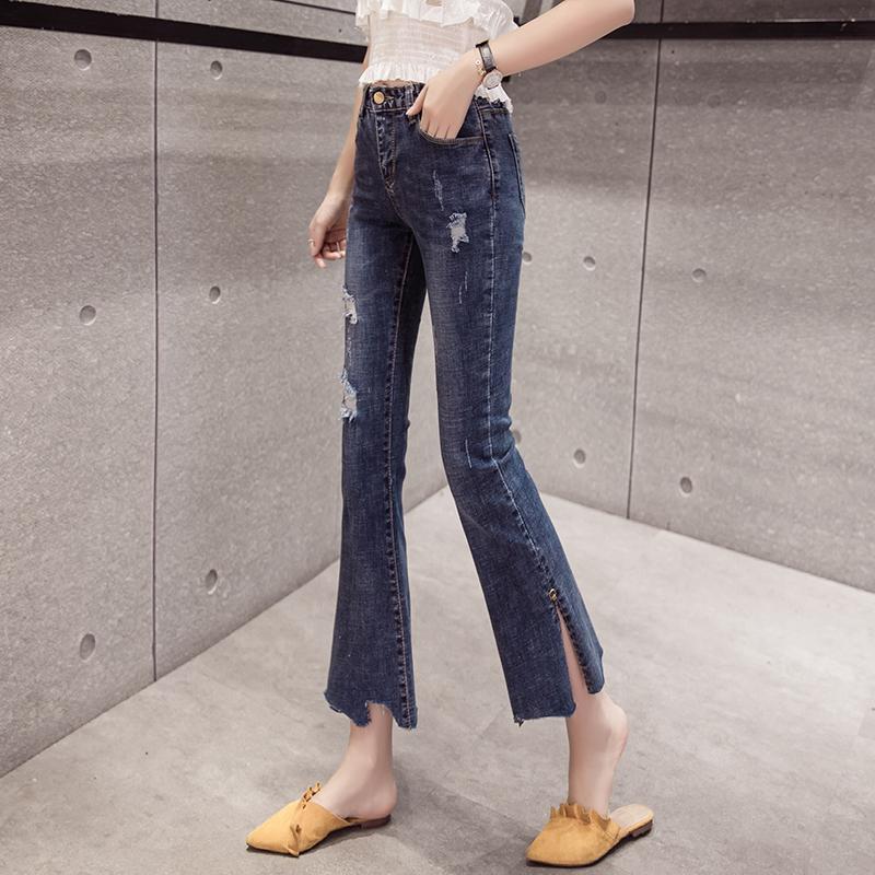 新款时尚学生百搭高弹显瘦气质侧开叉大长腿破洞九分牛仔喇叭裤女