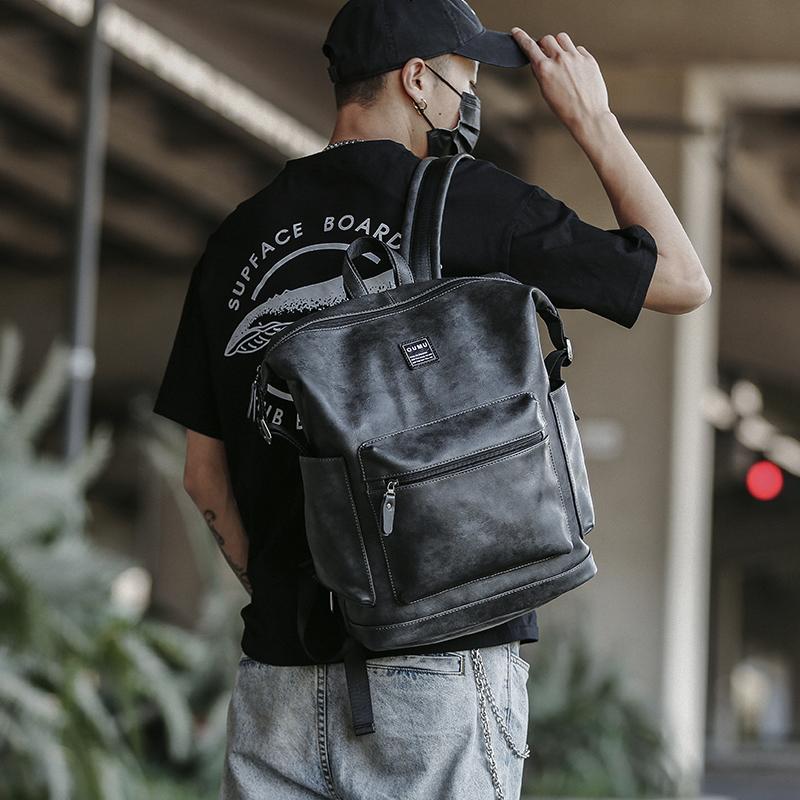 双肩包男韩版新款背包简约背包潮男双肩包大容量户外皮质电脑包