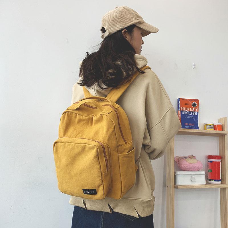 森系復古纯色百搭简约书包女高中大学生古着感双肩包旅行帆布揹包详细照片