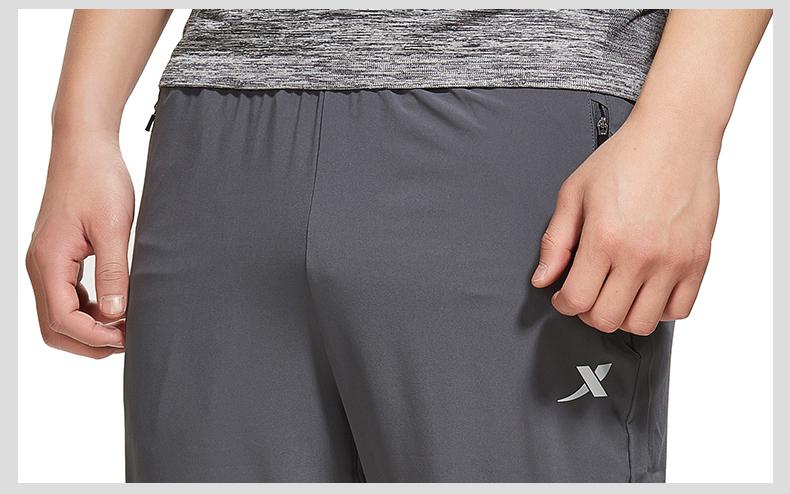 特步 专柜款 男子夏季长裤 运动健身梭织长裤982229980153-