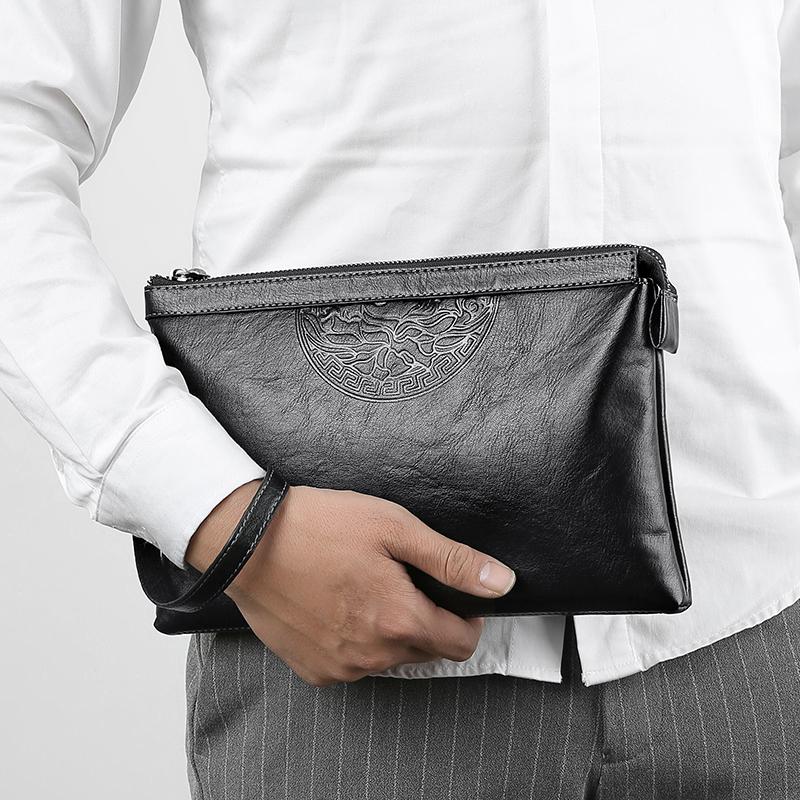 袋鼠真皮男包手包手拿软皮包商务大容量潮