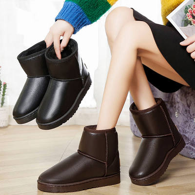 Winter new waterproof leather snow boots women's short tube flat-bottomed round toe short boots warm black thick and velvet cotton shoes