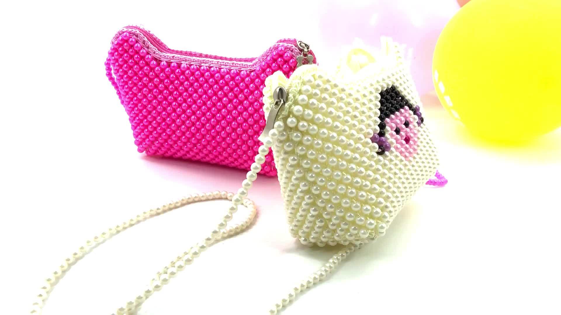 Fournisseurs en vrac de conception de mode en gros tissé à la main sac à main creux enfant perle sac