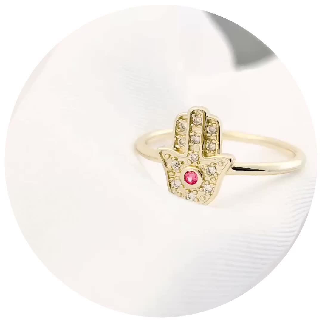 Delicate jewellery micro pave diamond gold Hamsa Hand ring with ruby