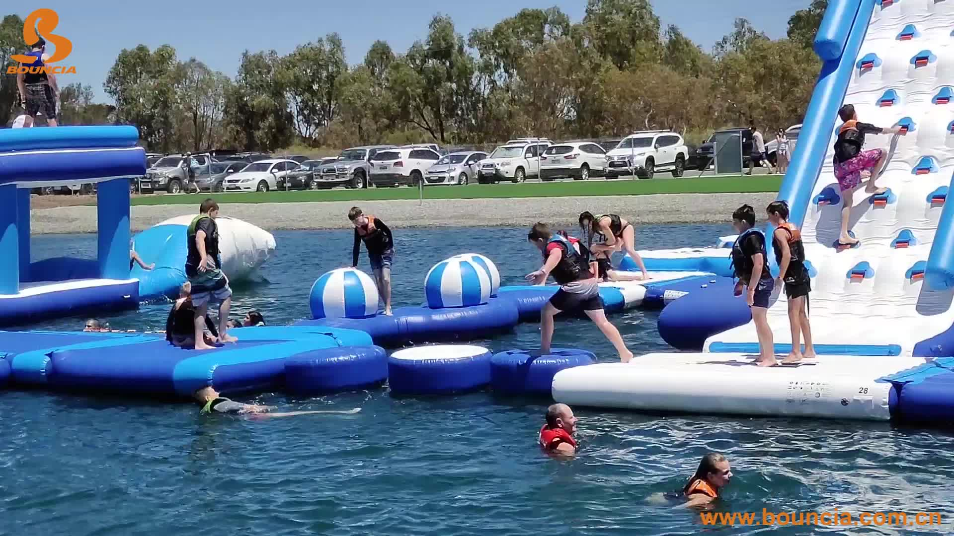 Bouncia New Giant Inflatable Floating Water Slide With TUV Certification