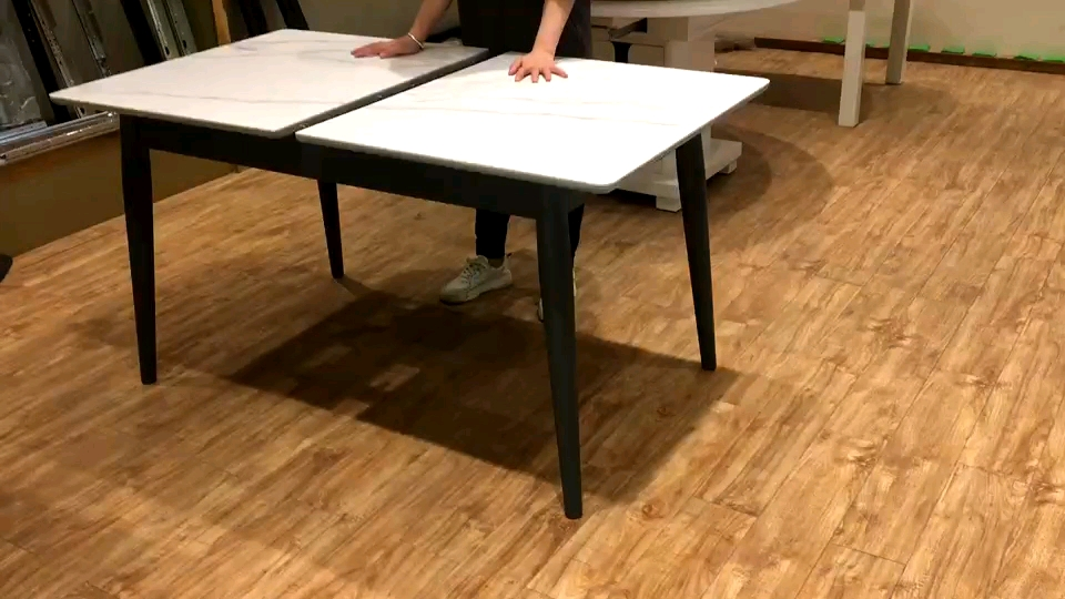 Synchronized Extension table slides for pedestal and four legged tables