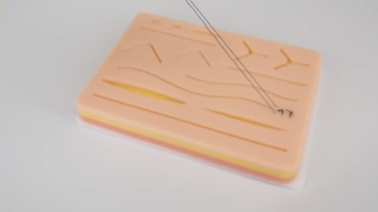 Pratica Sutura della pelle kit con Sutura Pad 3-Strato di Sutura Pad Con Le Ferite