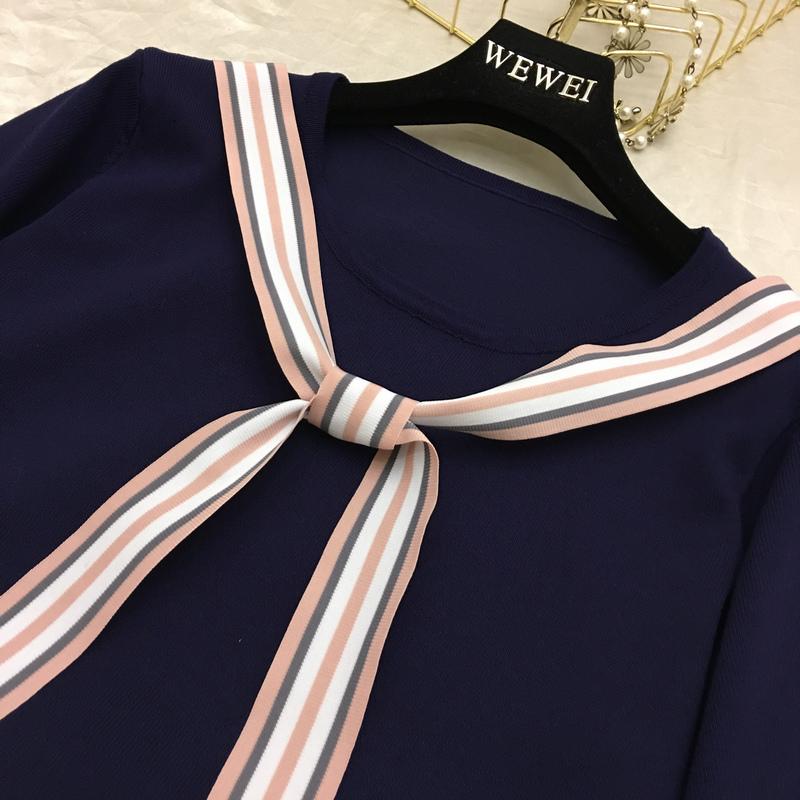 2018 mùa hè sản phẩm mới Han Fan Cao Đẳng gió tuổi va chạm màu bandage gỗ tay áo tai dệt kim tính khí ăn mặc
