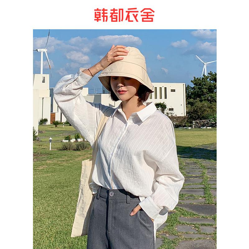 Handu cửa hàng quần áo sọc 2020 mùa xuân mới của phụ nữ Thiết kế Hàn Quốc phong cách nước ngoài lỏng lẻo áo dài tay thủy triều - Áo sơ mi