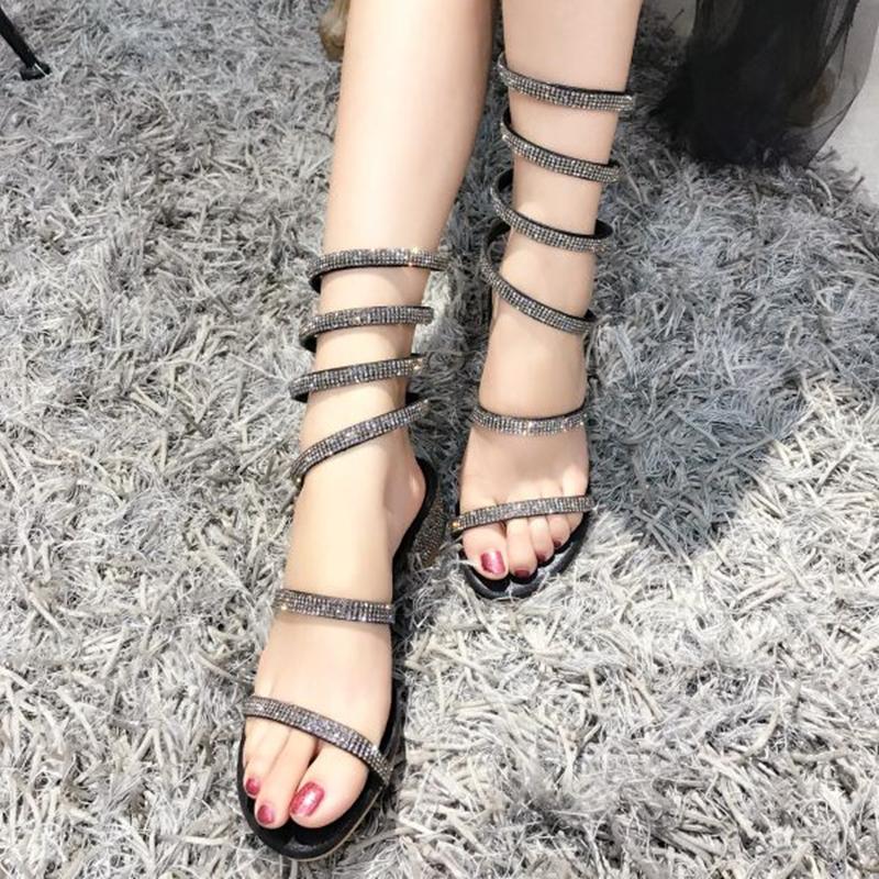 蛇形缠绕凉鞋2018夏新款一字带网红粗跟绑带凉拖鞋女罗马中跟水钻