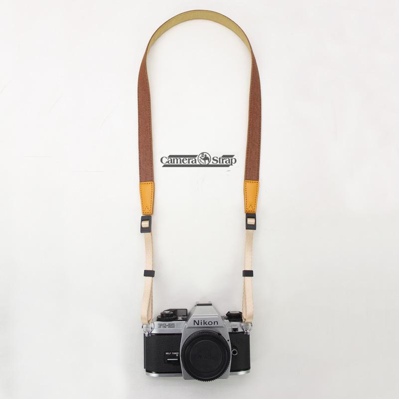 Фотография способ ковбой узкий фасон камера ремень декомпрессия слегка один камера ремень бить стоять получить камера группа ретро зеркальные ремень