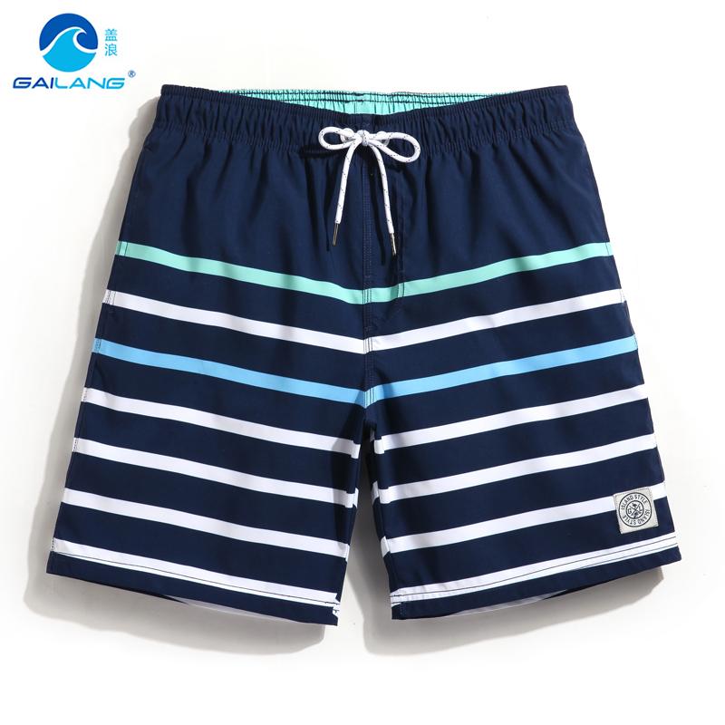Bìa sóng tốc độ khô không thấm nước sọc xu hướng bãi biển quần người đàn ông lỏng quần short thể thao kỳ nghỉ lót võ sĩ quyền Anh thân