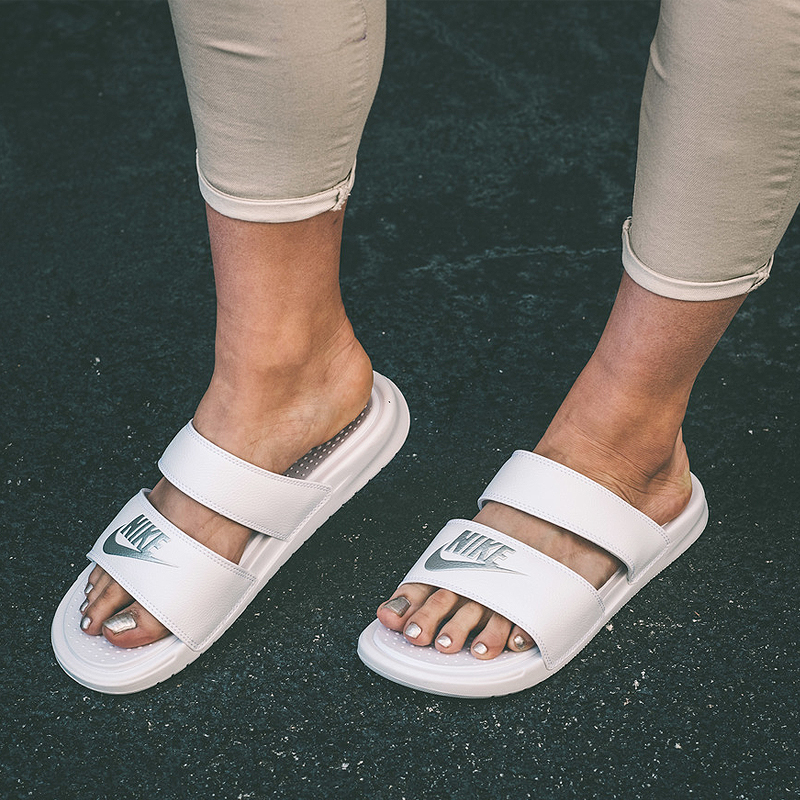 86c8b2f37860 ... promo code for nike benassi black and white ninja double strap sandals  men and women couple