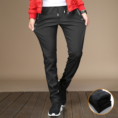 Autumn and winter Korean trend velvet padded youth casual pants men's junior high school students front feet