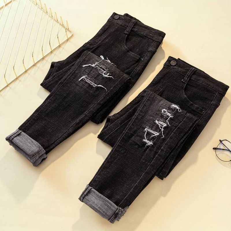 春秋季大码乞丐高腰破洞牛仔裤女装黑色铅笔女士裤学生九分长裤子