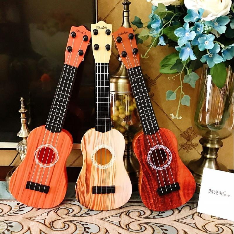 Little guitar Kerry six string four Qin 28 inch string type beginner musical instrument high quality personality Mini children environmental protection