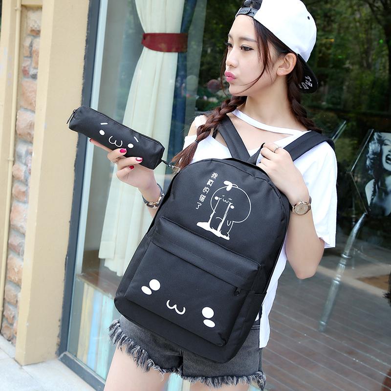 送笔袋可爱表情帆布包小学生男双肩包女孩子旅行背包初中学生书包