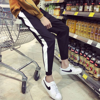 Pants male spring student Korean version of the trend of nine pants loose wild striped casual sports pants feet harem pants