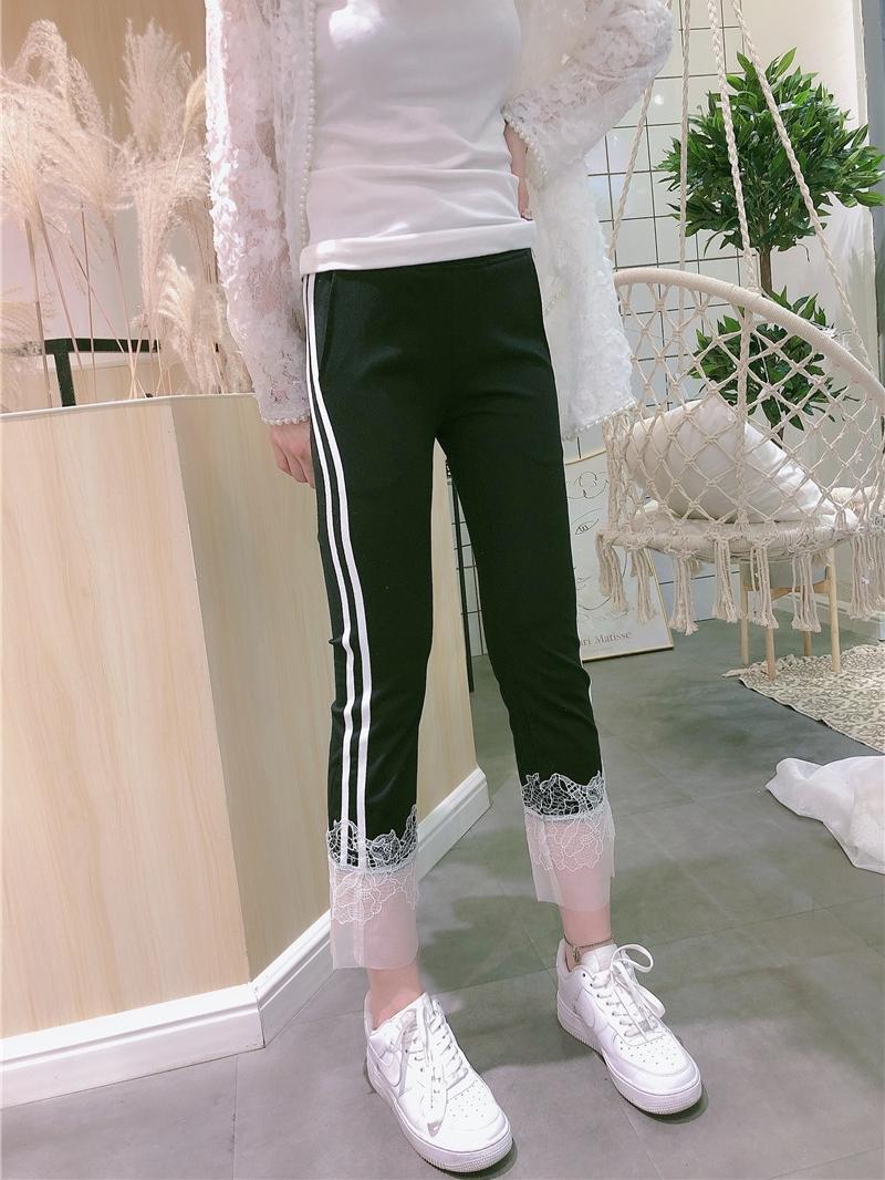 Quần legging thun ngoài nữ mùa hè Hàng châu Âu 2020 mới khâu ren eo cao là dải trắng mỏng chín điểm quần đen nhỏ - Quần tây thường