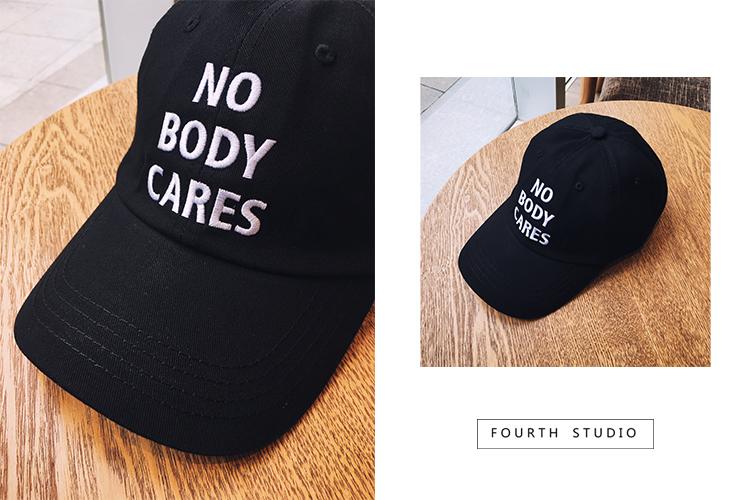鴨舌帽國純色彎簷棒球帽NO BODY CARES刺繡男女情侶休閒帽子