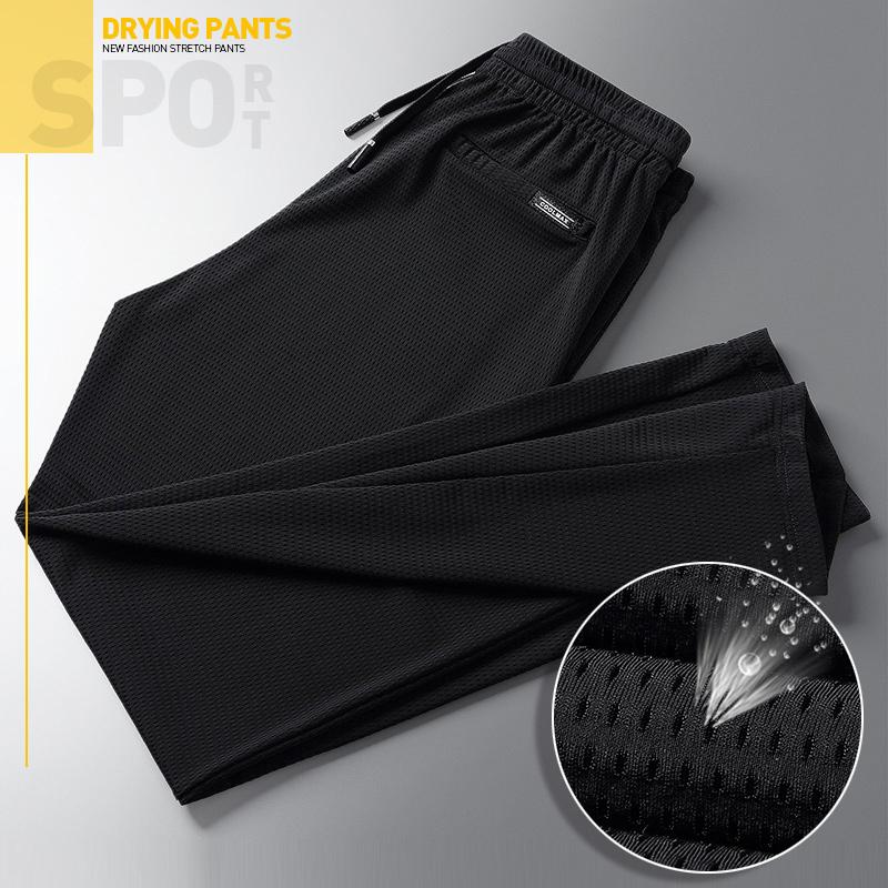 夏季薄款冰丝网眼裤子加肥加大男裤休闲裤透气宽松空调速干运动裤