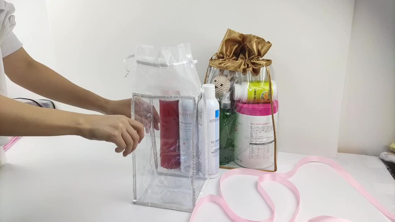 Promotional clear vinyl drawstring bag with organza
