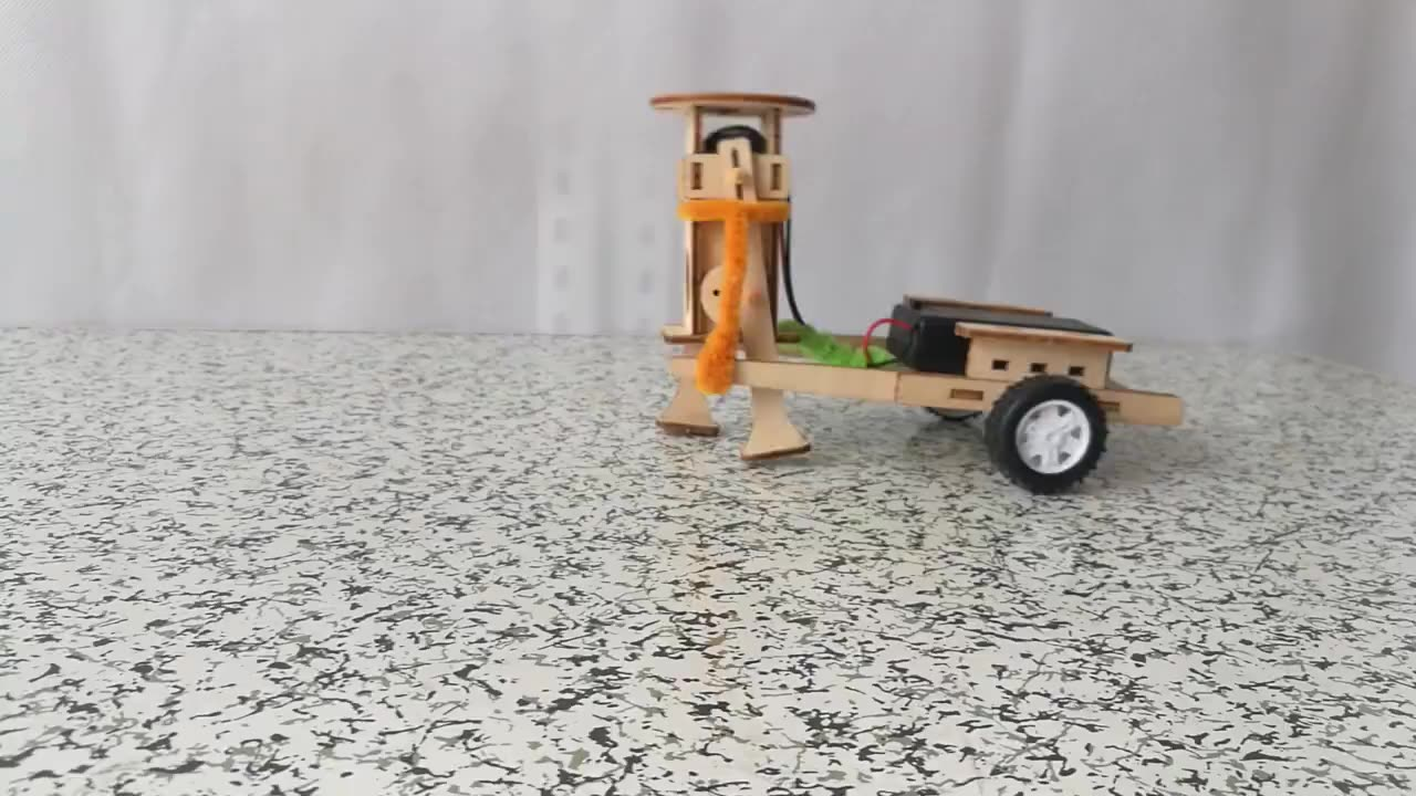 Students handmade cute cart pulling robot diy stem toys for kids