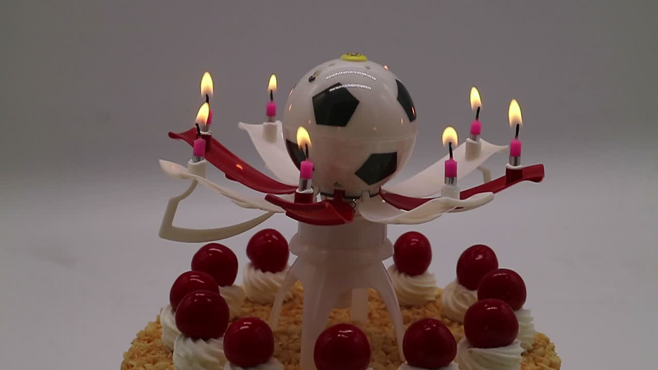 Customized rotate football shape music birthday candle