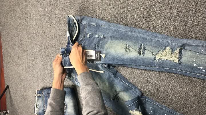 男性ジーンズストレッチ破壊リッピング雪ペイントポイントボタンファッション足首ジッパースキニーバイカージーンズ男性のためのパンツ