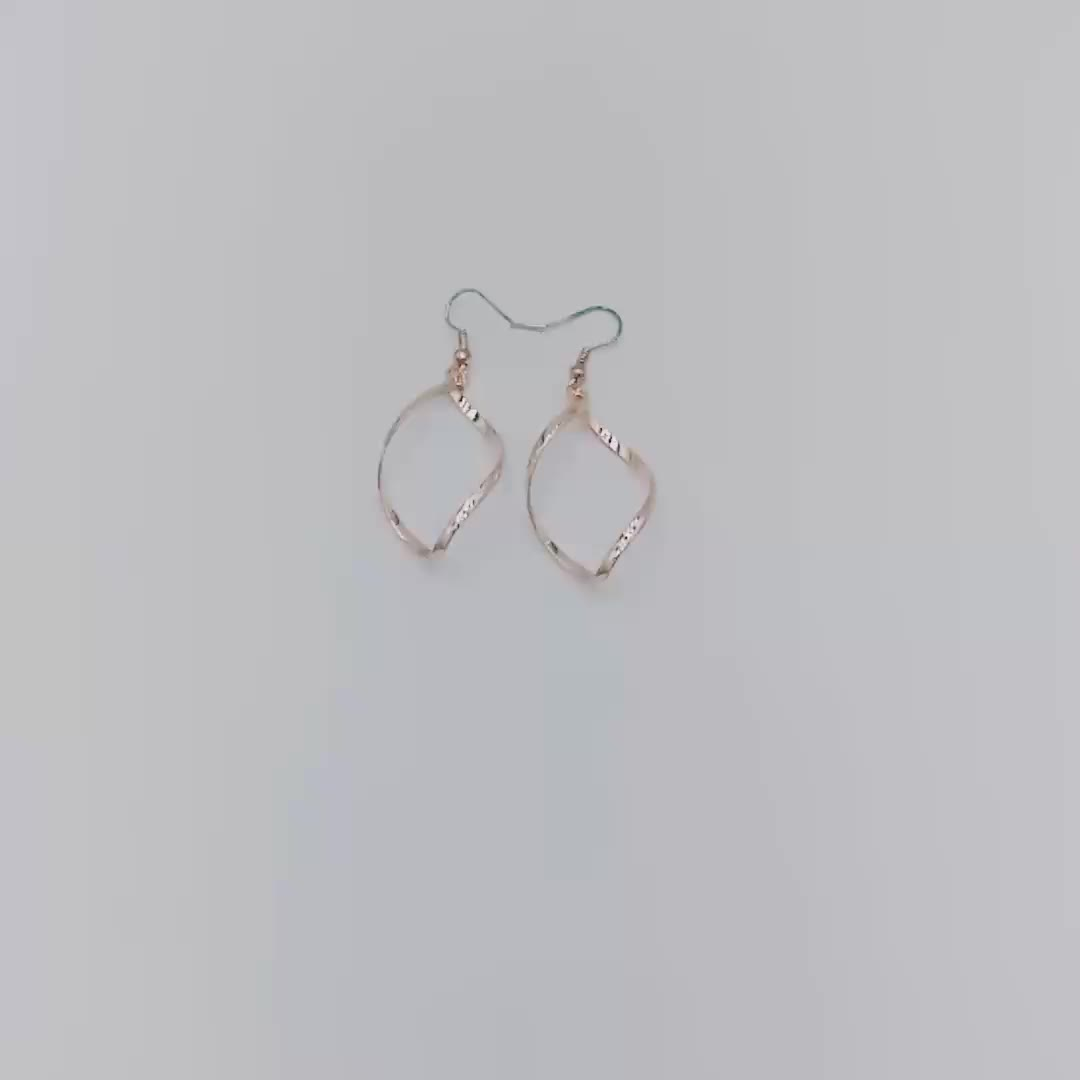 Fancy Twisted Spinning Design Metal Drop Hook Earrings