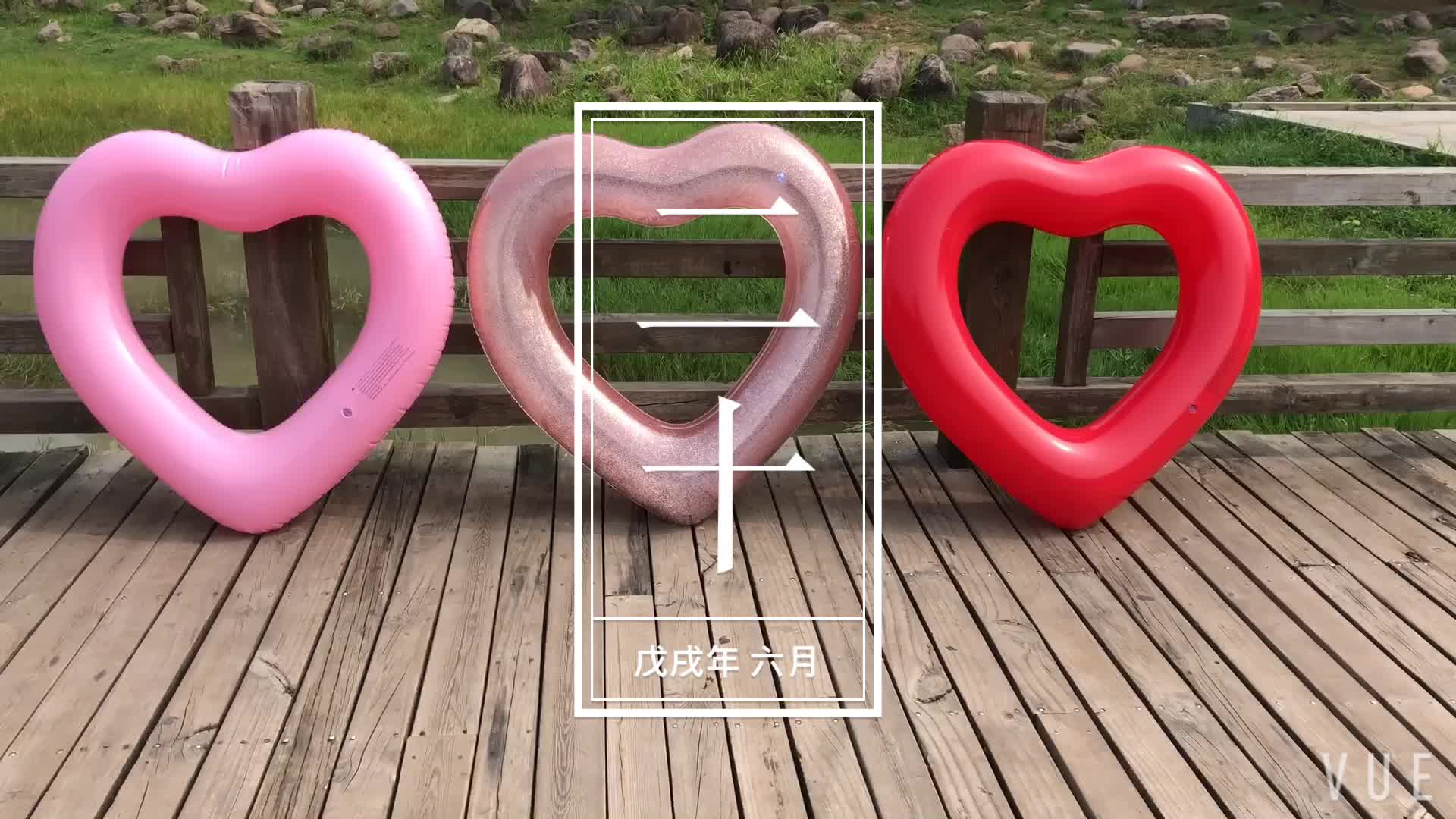 factory hot selling Summer water and beach toy top quality cheap inflatable pink heart shape adult swim ring for adults