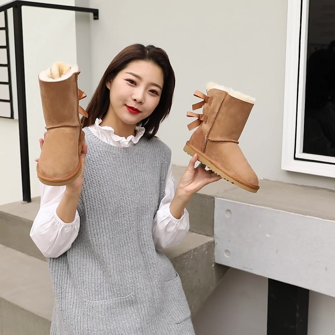Wholesale 2020 hot colorful winter warm boots with two bows real wool fashion  high uggh boots for women