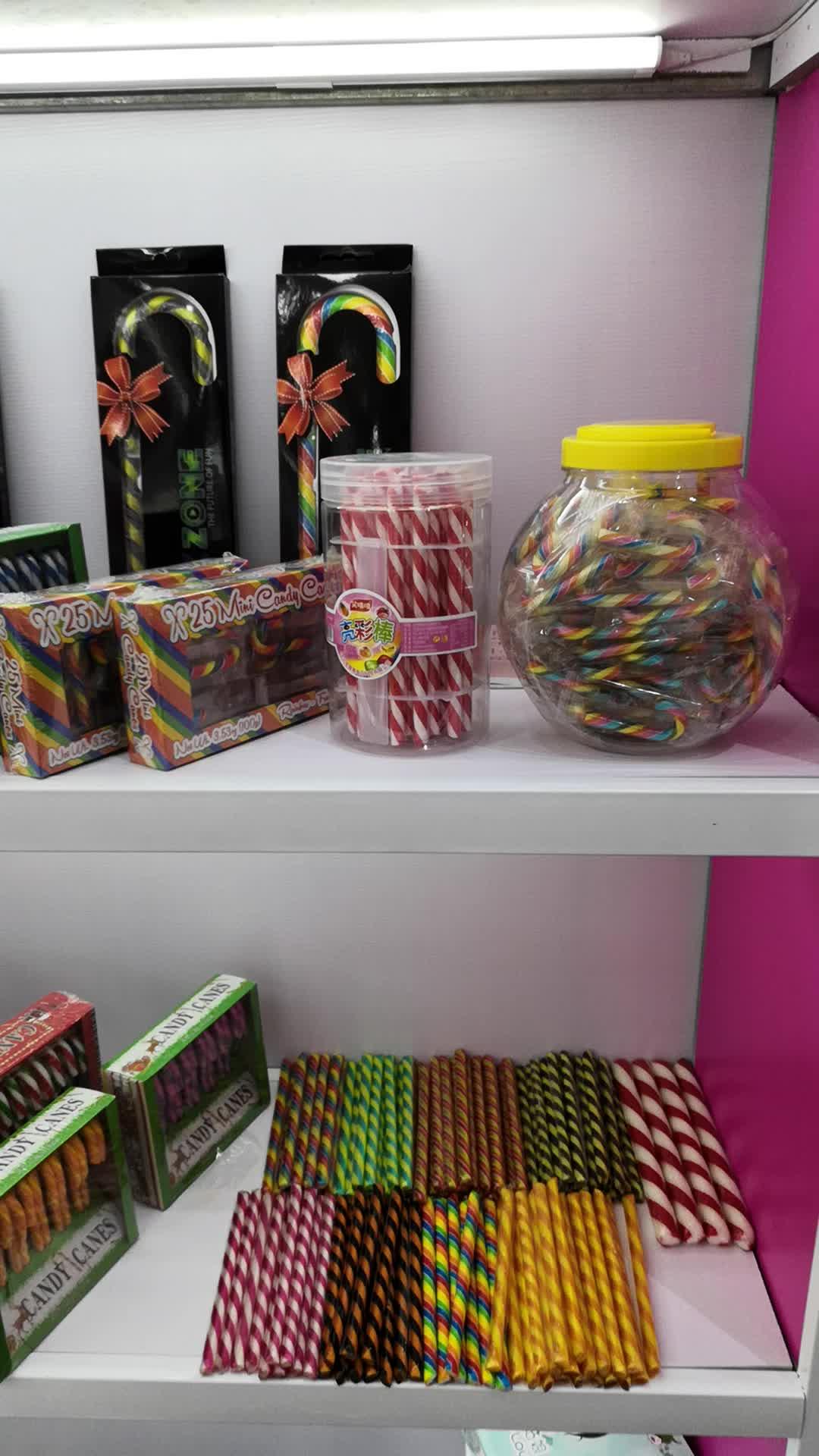 Vendita calda della caramella bastone bottiglia di imballaggio FDA lecca-lecca caramelle sapore di miele caramelle e dolci 15g