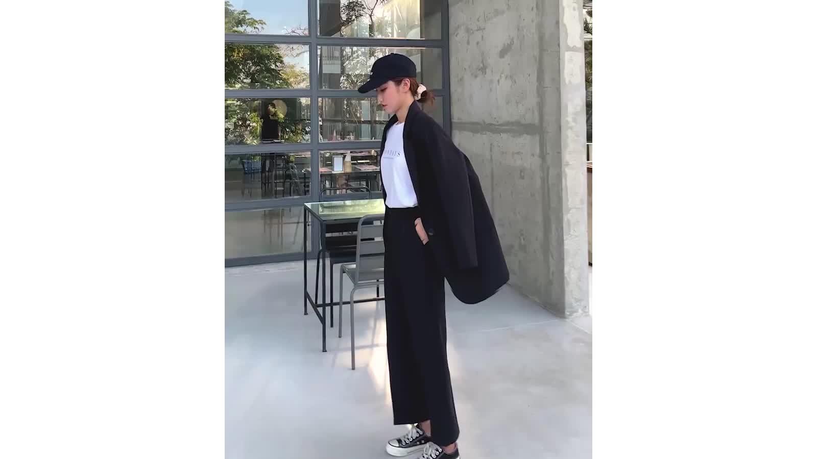 Musim Semi dan Musim Panas Elastis Pinggang Tombol Zipper Longgar Jas Wanita Celana